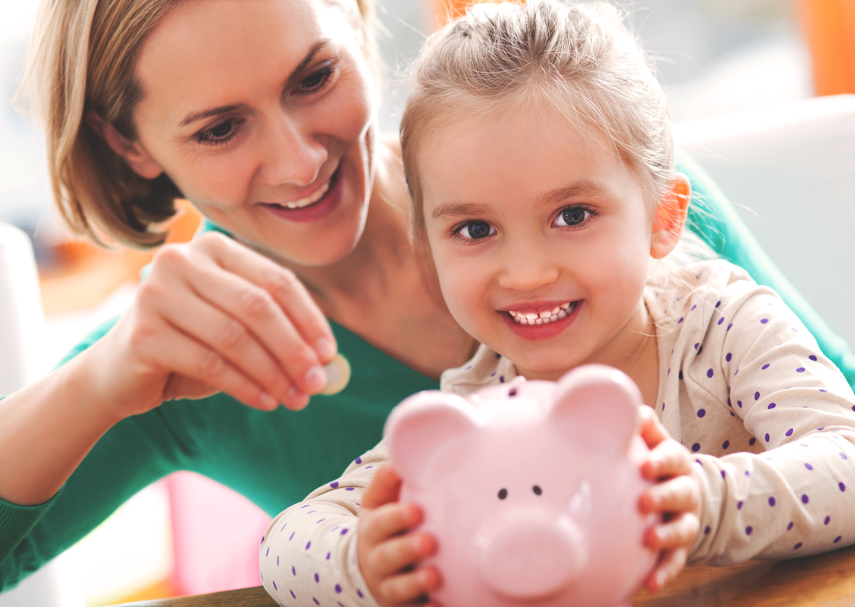 mother and child with piggy bank