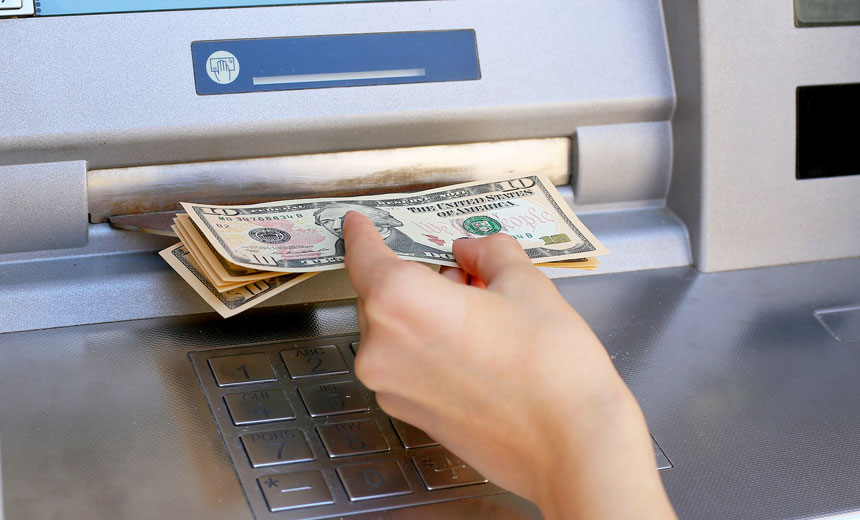 hand reaching for cash at atm